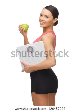 picture of sporty woman with apple and weight scale
