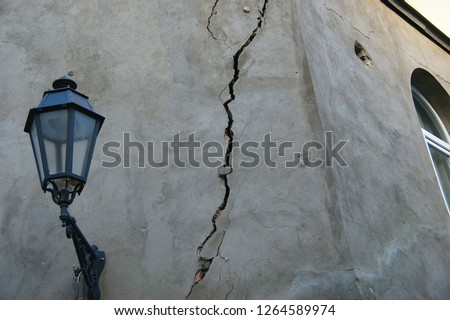 earthquake damage. cracked wall after earthquake Royalty-Free Stock Photo #1264589974