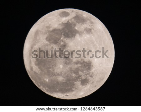 Full moon on dark night sky. The full moon is lunar phase when It appears fully illuminated from Earth's perspective. It occurs when Earth is located between Sun and Moon appears as a circular disk #1264643587