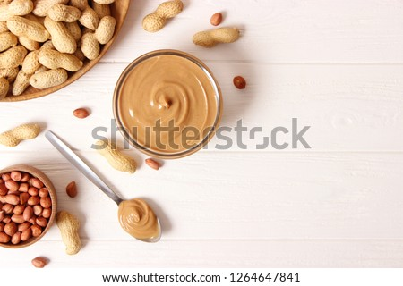 peanut butter and peanut beans on wooden background #1264647841