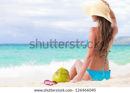 Happy young woman smiling in straw hat with closed eyes on the beach #126466040