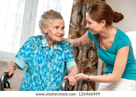 Senior woman with her caregiver at home #126466499