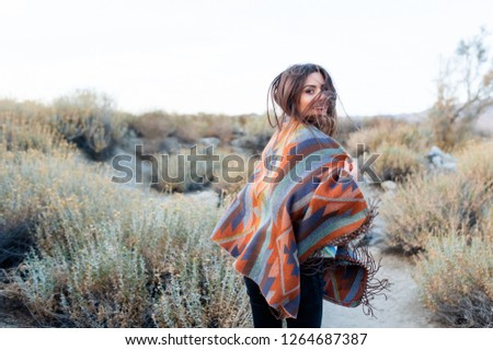 Hipster girl in gypsy look, young traveler in the desert nature in Coachella Valley, California, USA. #1264687387