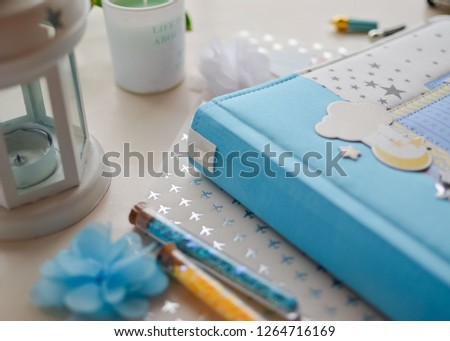 Top view of table with elements for scrapbooking. Kids scrapbooking photo album   #1264716169