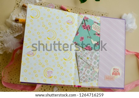 Top view of table with elements for scrapbooking. Kids scrapbooking photo album   #1264716259