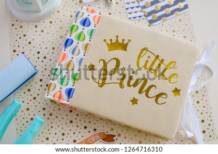 Top view of table with elements for scrapbooking. Kids scrapbooking photo album   #1264716310