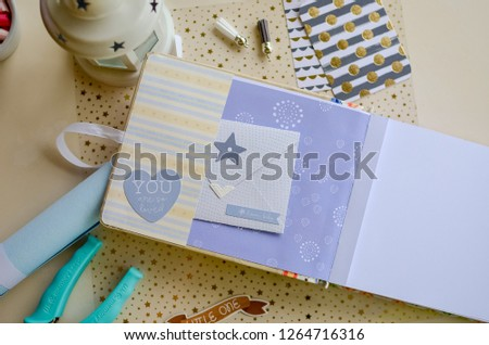 Top view of table with elements for scrapbooking. Kids scrapbooking photo album   #1264716316