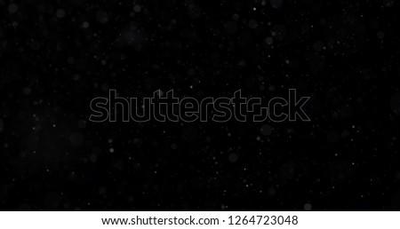Snowfall on a black background #1264723048