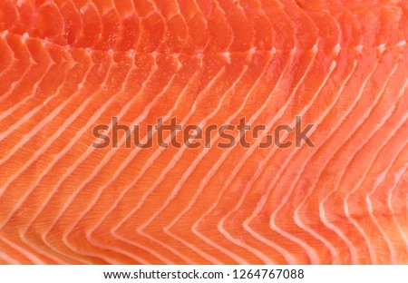 Natural Atlantic Norwegian Salmon Fillet Texture or Pattern Closeup. Macro Photo Fresh Red Fish or Trout Background Top View #1264767088