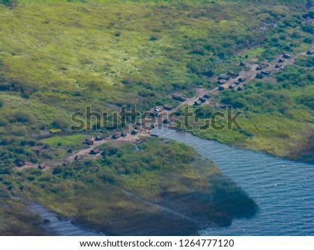 Small village by the shore of Lake Mweru, near Pweto, Katanga, Democratic Republic of Congo. Aerial shot #1264777120
