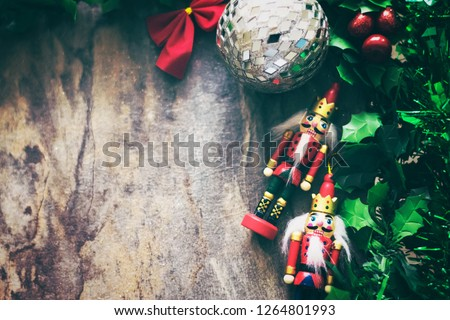 Christmas background frame with fir branches and other decorations with  red ribbon bow with ornament bauble on vintage wooden table with copy space still. #1264801993