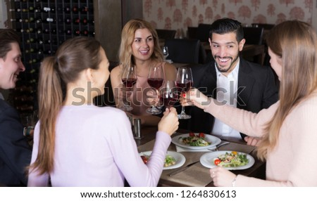 happy friendly meeting over dinner with wine in restaurant #1264830613
