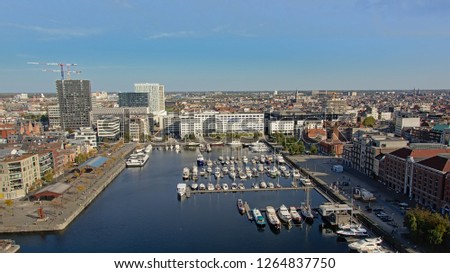 ANTWERP, BELGIUM, OCTOBER 13, 2018, Aerial view on `Willemsdok` dock with leisure boats and surrounding apartment and office buildings in the port Antwerp, 13 October 2018  #1264837750