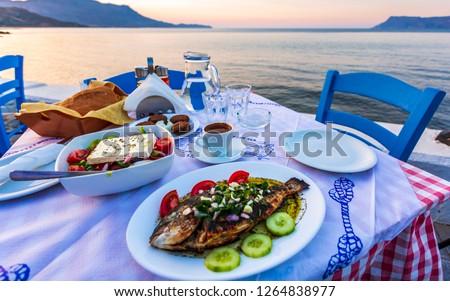 Traditional Cretan Dorada fish with Greek salad, Kissamos, Crete, Greek Islands, Greece, Europe #1264838977