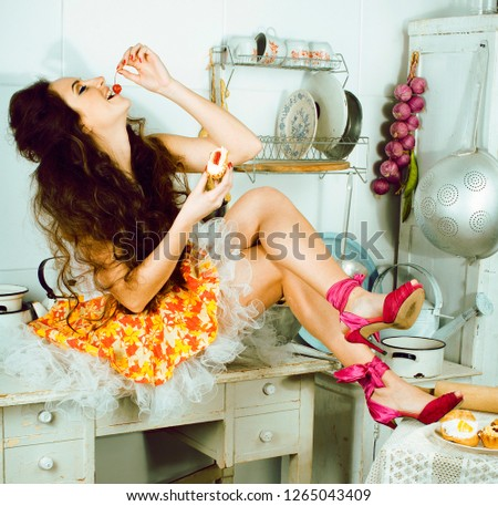 crazy real woman housewife on kitchen, eating perfoming, bizare #1265043409