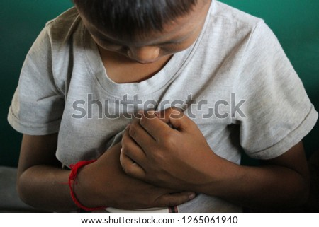 The boy uses the handle on his chest because he feels pain #1265061940