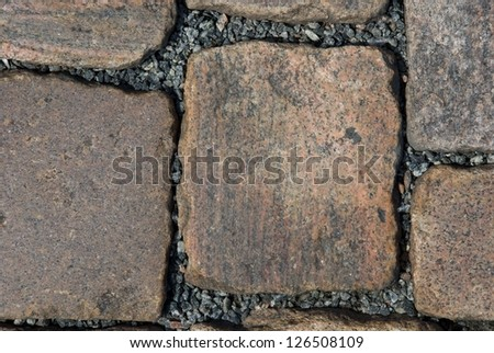 a sidewalk build of granite cobblestone #126508109