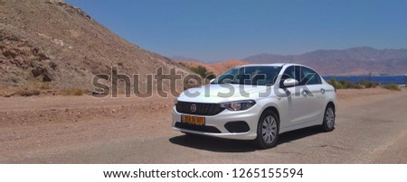Eilat, Israel - 12 23 2018: White Car in Eilat Mountains Near the Red Sea #1265155594