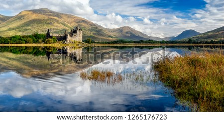 The ruins of Kilchurn castle are on Loch Awe, the longest fresh water loch in Scotland. It can be accessed on foot from Dalmally road on the A85. This image was taken from the opposite bank.  #1265176723