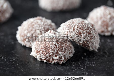 sweet mallow snowballs with chocolate coating and coconut #1265266891