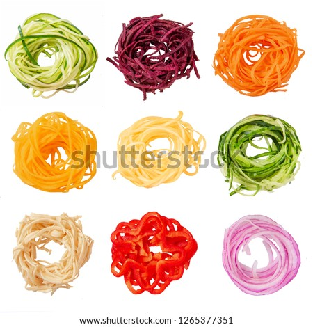 set of various vegetable noodles. spiralized zucchini, beets, pumpkin, squash, sweet potatoes, cucumber, vegetable banana, red pepper, red onion.  isolated on white background. #1265377351