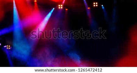 floodlights scene during a rock concert. Blurred background. Web banner. Element of design. Royalty-Free Stock Photo #1265472412