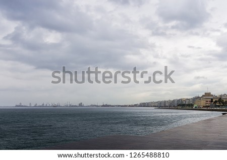 The waterfront of Thessaloniki, Greece, under a cloudy sky Royalty-Free Stock Photo #1265488810
