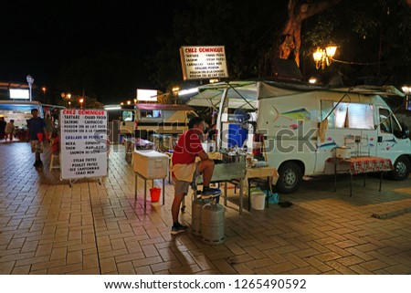 PAPEETE, TAHITI -10 DEC 2018- View of the roulotte food trucks coming down every night on the waterfront in the port of Papeete, Tahiti, French Polynesia. #1265490592