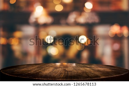 Selective Empty wooden table in front of abstract blurred festive light background with light spots and bokeh for product montage display of product. Royalty-Free Stock Photo #1265678113