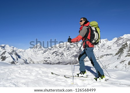 Ascending to the top. Ski mountaineering cross country skiing in Italian Alps, Cervino Matterhorn #126568499