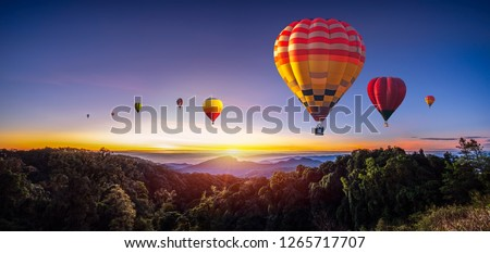 Colorful hot air balloons flying over mountain at Dot Inthanon in Chiang Mai, Thailand #1265717707