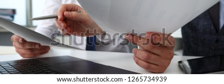 Group of people hold in arms financial papers solve and discuss problem closeup. Fresh view review situation new angle look professional training white collar investment and finance concept #1265734939