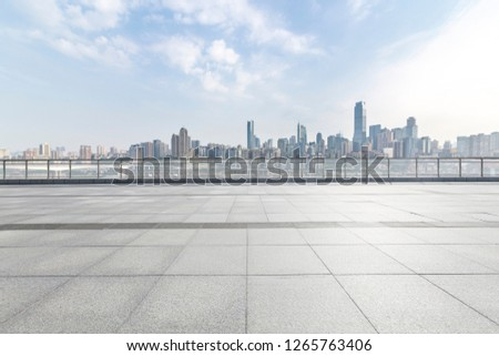 Panoramic skyline and modern business office buildings with empty road,empty concrete square floor #1265763406