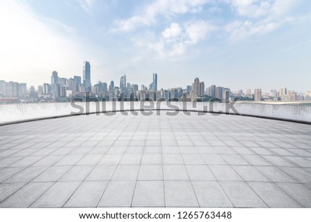 Panoramic skyline and modern business office buildings with empty road,empty concrete square floor #1265763448