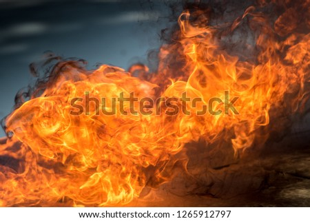 The background of the hot fire was lit up to illustrate the heat of the flame and was used for initial firefighting for residents of a condo or city. Introduction to fire and firefighting.