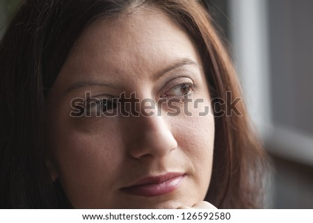 Portrait of a young woman looking away from the camera #126592580