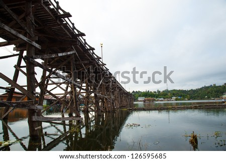 Wooden bridge across the river. The wood construction is to cross to the other side. #126595685