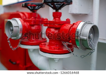Industrial transfer of the red fire hydrant. Water fire extinguishing system. Fire safety. Manual gate valve on the fire hydrant. #1266016468