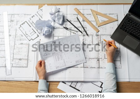 High angle above top view cropped clever professional lady in her formal wear she sit at the desk on workstation check information about building in paper blank or document #1266018916