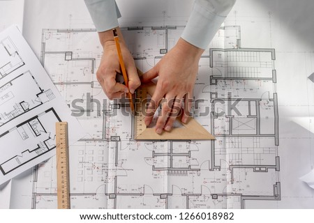 High angle above top flat lay view cropped lady in her formal wear she stand at the table hold tool instrument in hands create new space in interior #1266018982