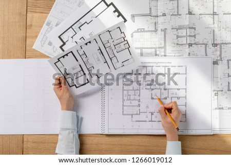 High angle above top view cropped collar profession occupation lady in her formalwear shirt she sit desk in light loft interior inspect read prepare analyzing expertise technical property draw #1266019012