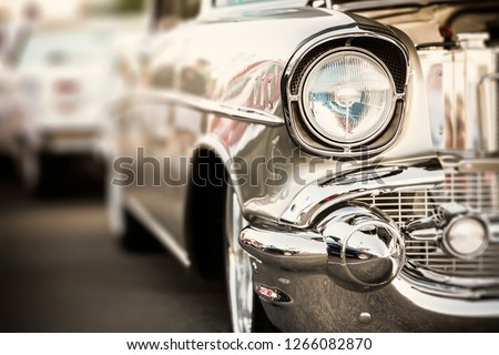 Classic car headlights close-up Royalty-Free Stock Photo #1266082870