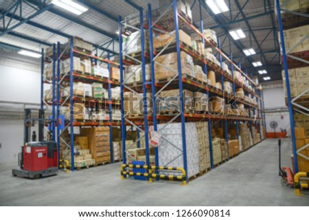 Blur Warehouse inventory product stock for logistic background, Long shelves with a variety of boxes #1266090814