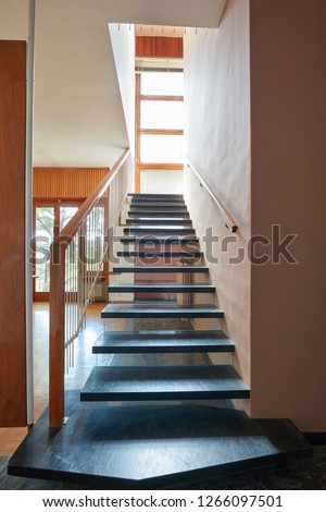 Black marble staircase in apartment interior in old house #1266097501