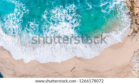 Aerial overview of huge waves crashing into the shore and rocks at Cala Mitjana, Mallorca, overview shot showing the dynamic coastline of the turquoise waters of Mallorca spain. Royalty-Free Stock Photo #1266178072