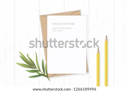 Flat lay top view elegant white composition letter kraft paper envelope yellow pencils and tarragon leaf on wooden background. #1266189496