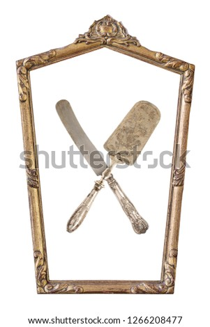 Vintage gilded pentagonal frame and crossed cake shovel and knife with an ornament isolated on white. Retro style.