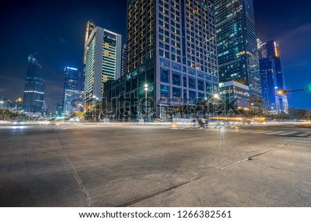 empty concrete floor and cityscape at night #1266382561