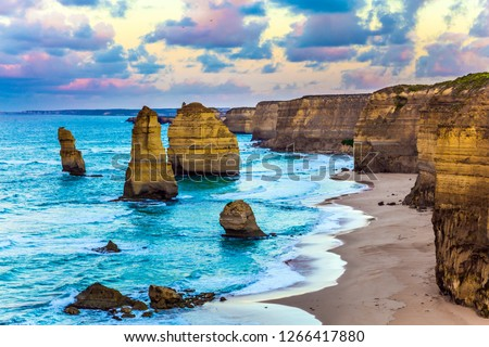 """Early morning on the ocean coast. The clouds over the well-known rocks """"Twelve apostles"""". Travel to Australia. Concept active, ecological and phototourism"""