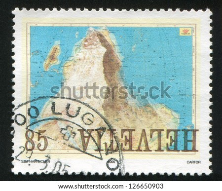SWITZERLAND - CIRCA 2005: stamp printed by Switzerland, shows Matterhorn superimposed over inverted map of Africa, circa 2005 #126650903